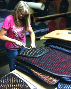 CocoMats.com Employee Diana cleaning the coco mats prior to heel pads going on.