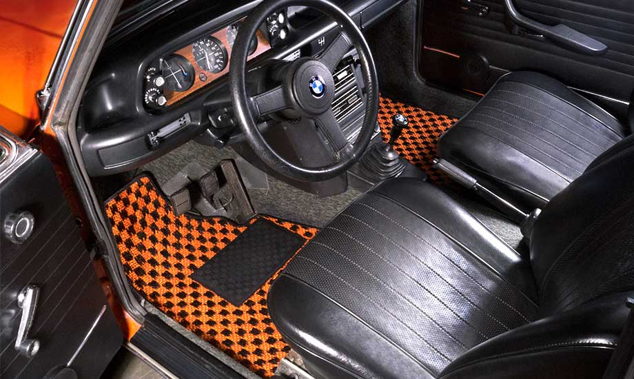 Cocomats.com Chequers Mats car mats Color Black and Orange Number 106 in a BMW 2002